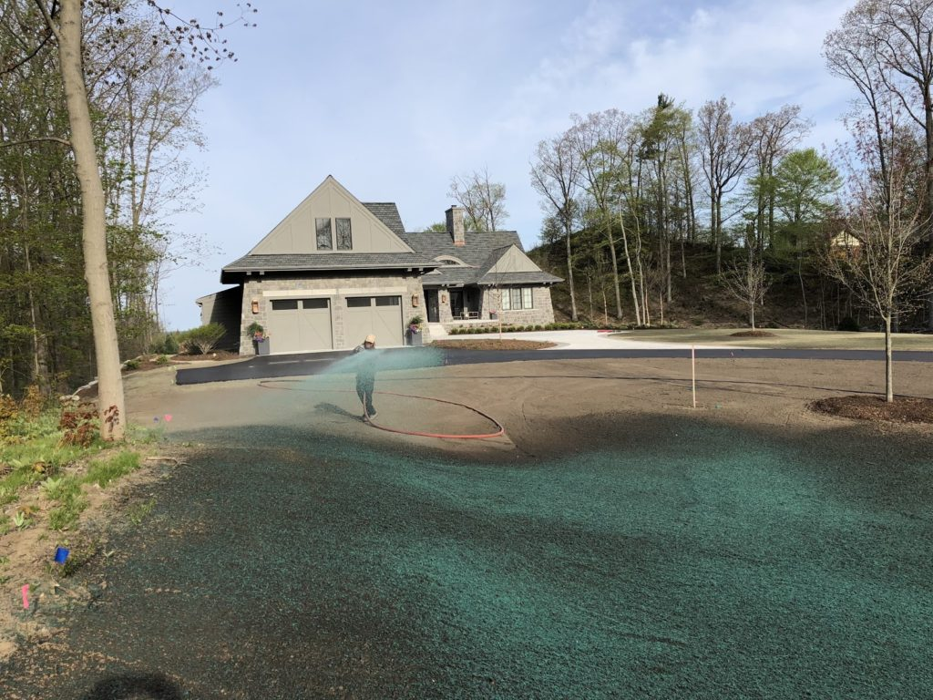 Hydroseeding in wooded neighborhood