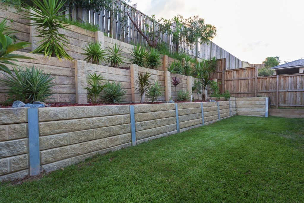 Multi level retaing wall with plants in backyard