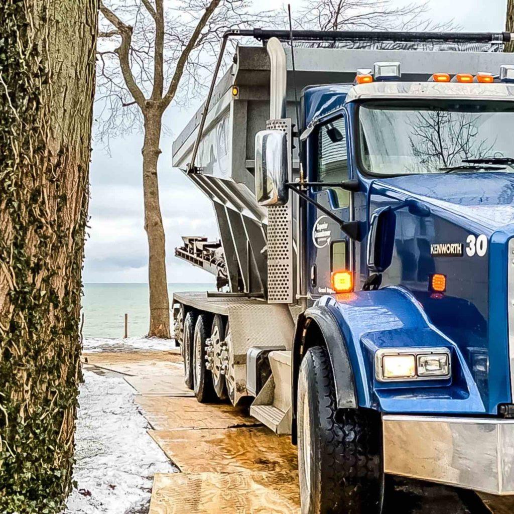 Stone slinger truck for backfill