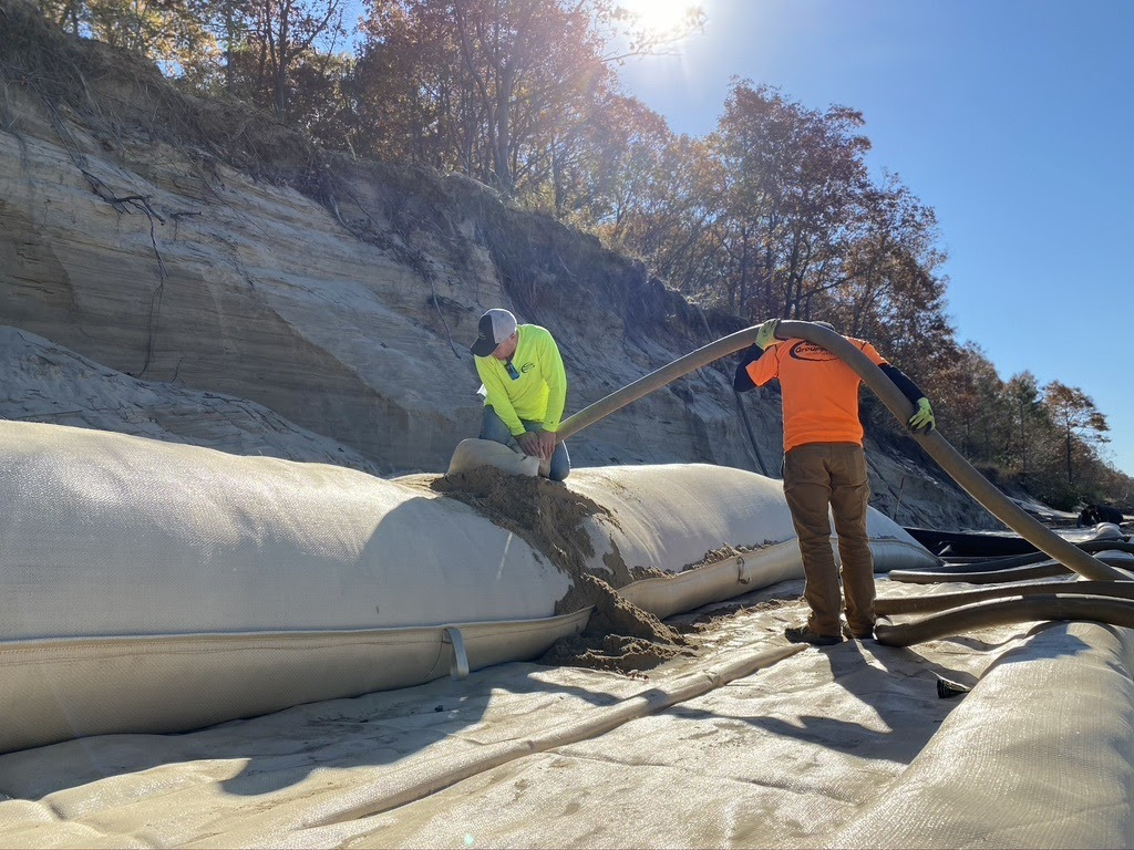 sand loaded into geotextile bags