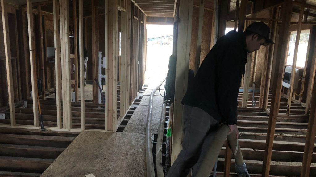 man working on a crawl space