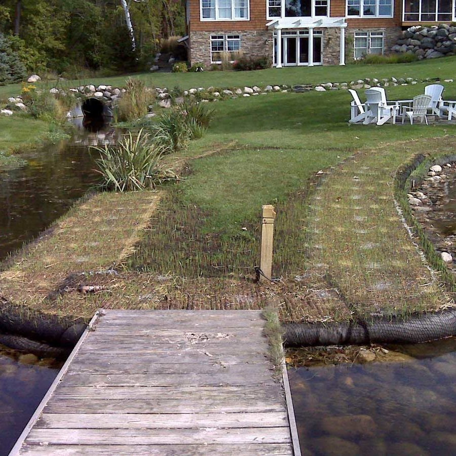 Compost Filter Socks around shore outcropping