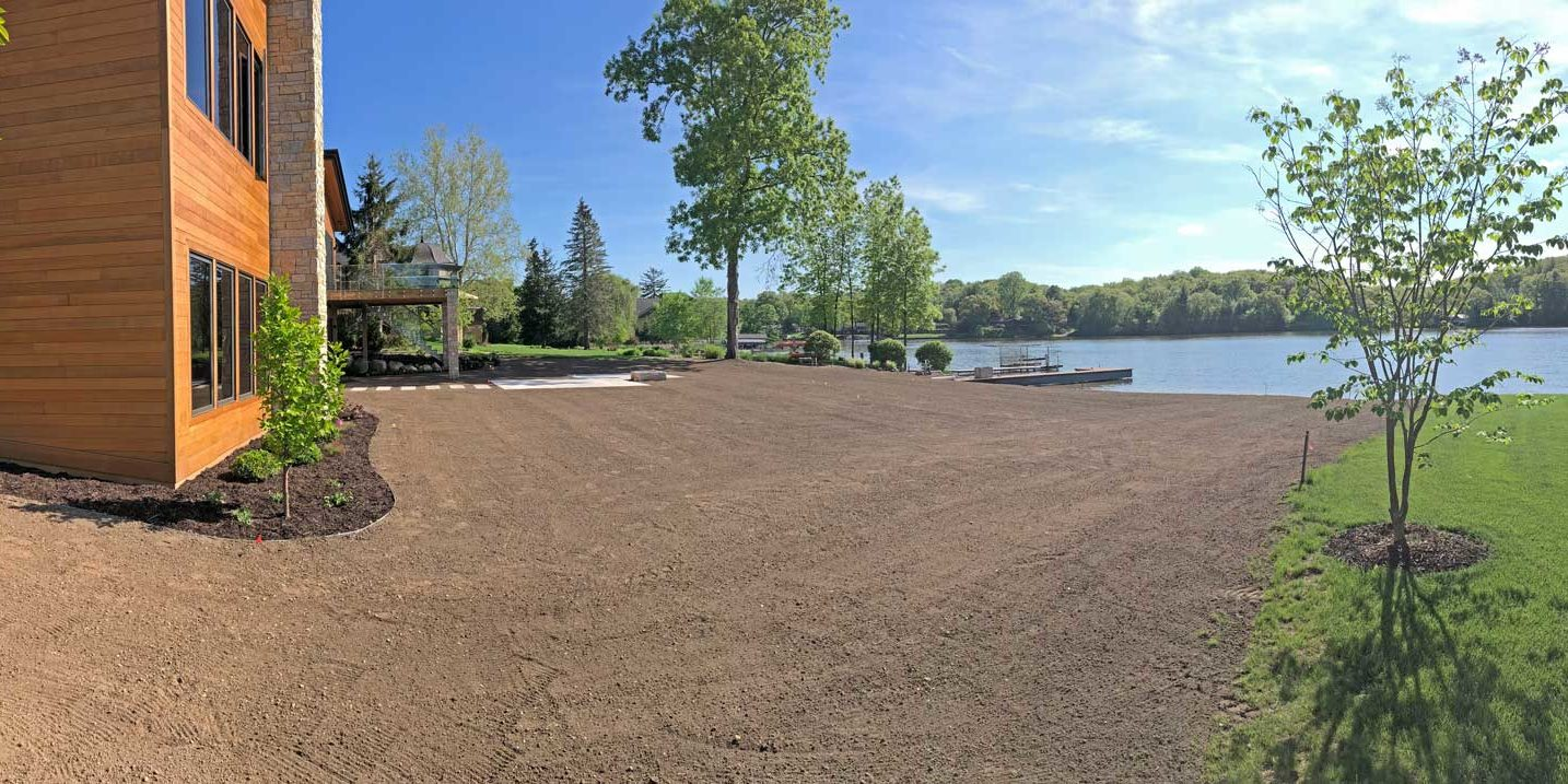 a waterfront lawn site ready for hydroseeding