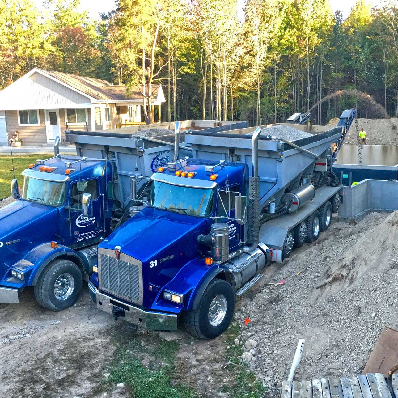 two stone slinger trucks